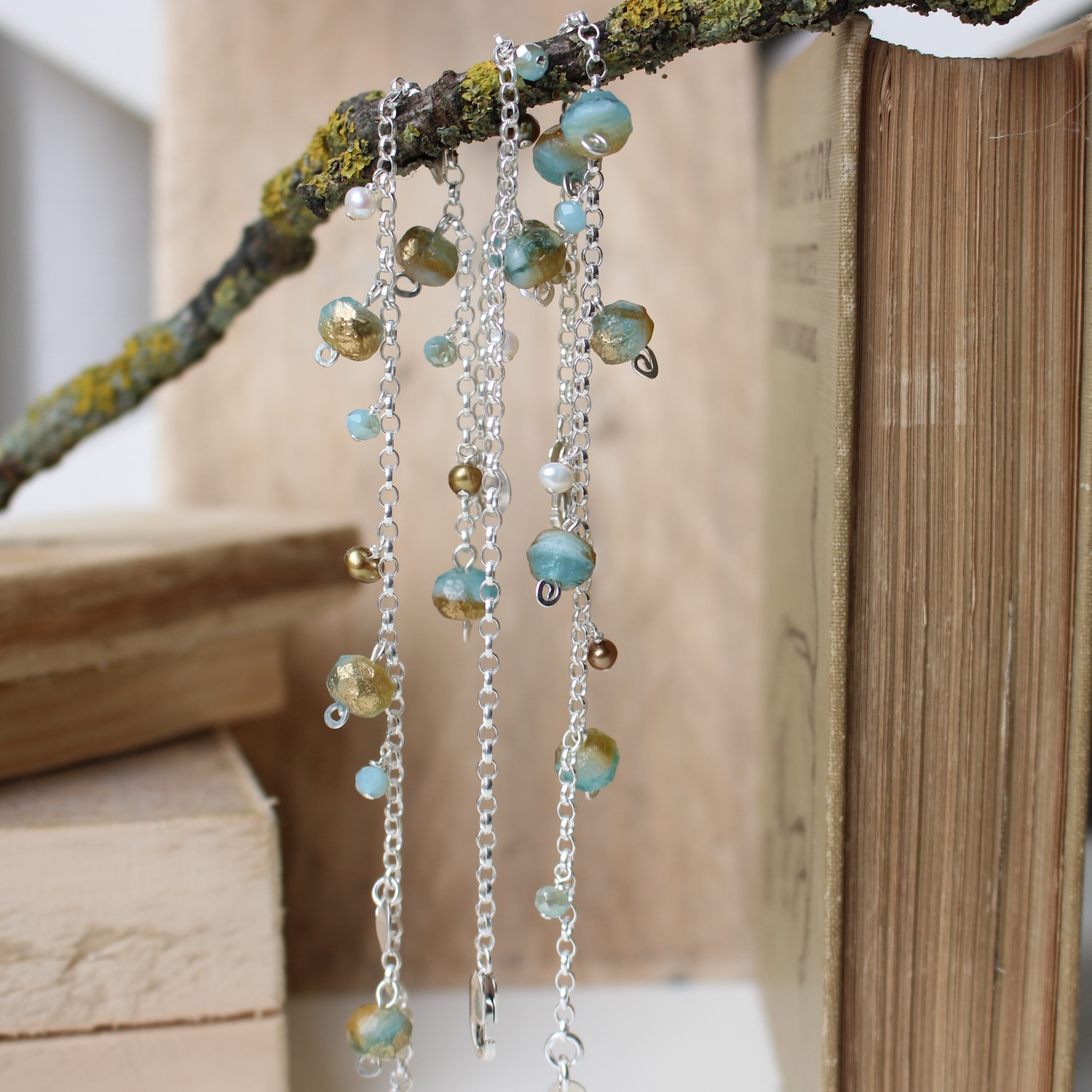 Soft Blue and Gold drops on Sterling silver with pearls. By Nina Parker