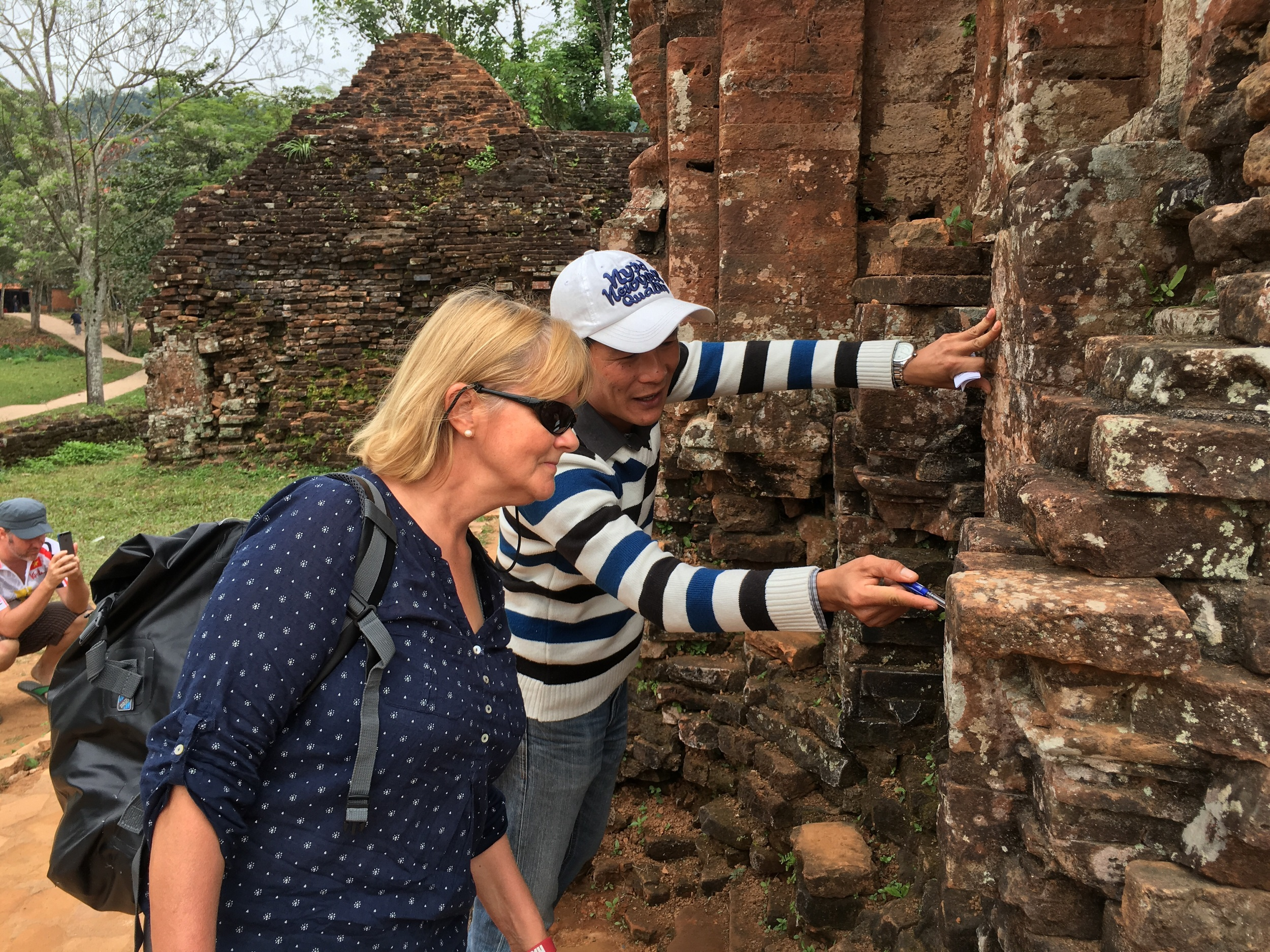 Quan points out the mystery of the absence of mortar in this 1000 year old archeological wonder.