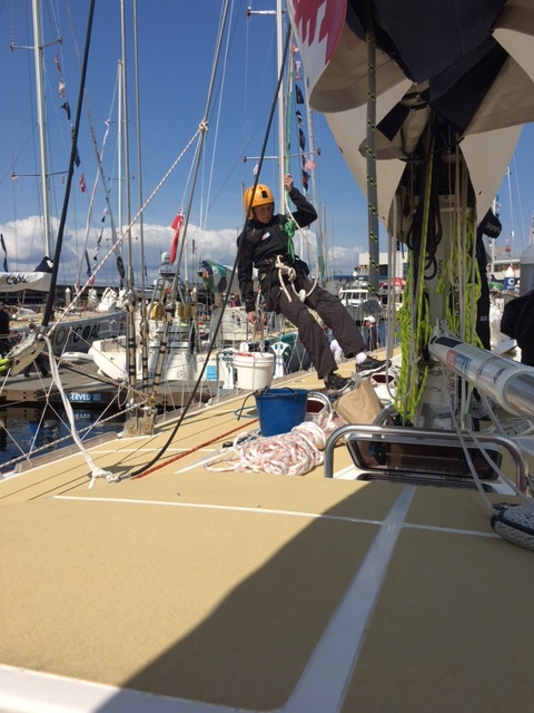 Linda goes up the mast for rigging work