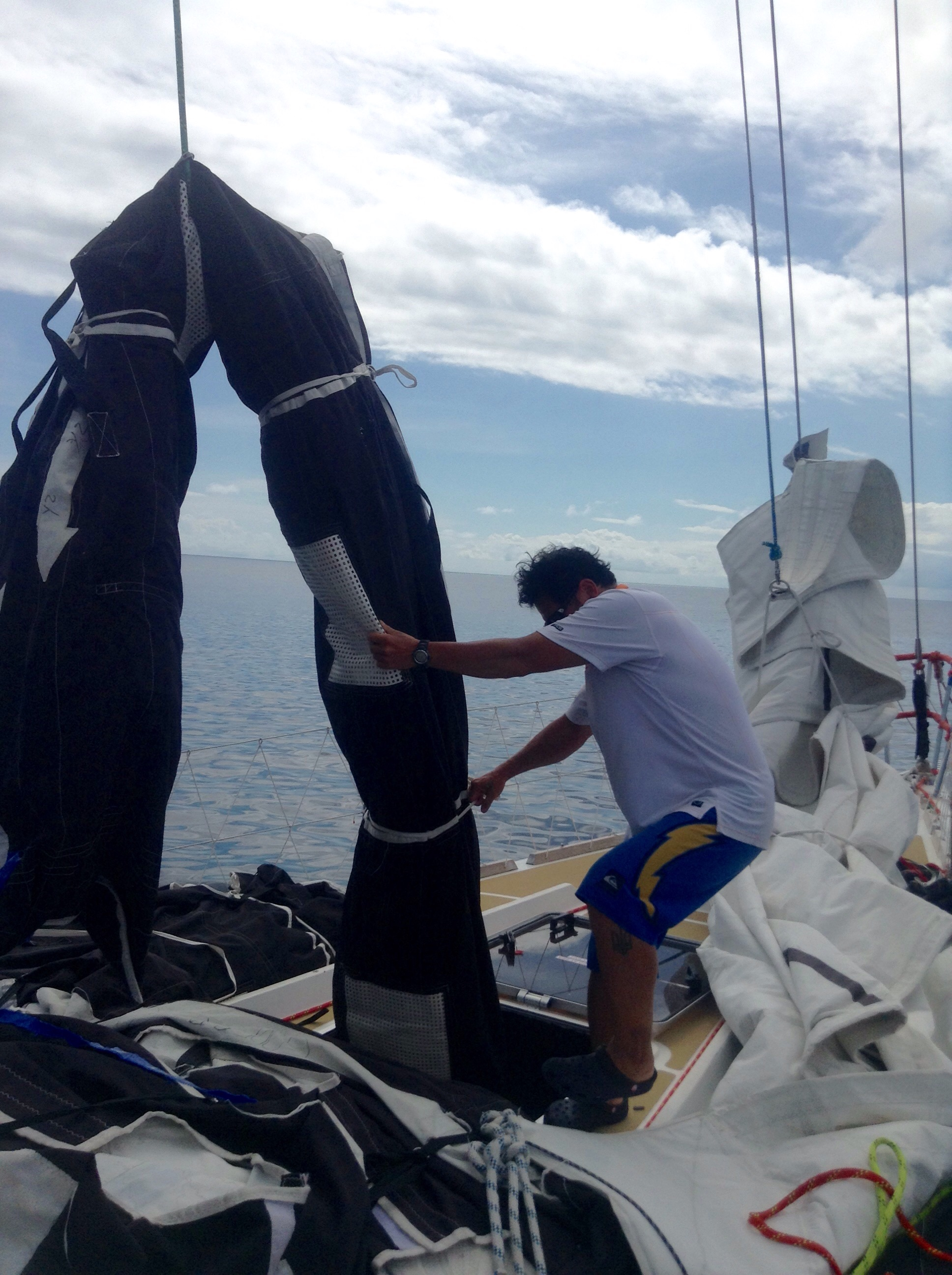 Han used a halyard to help muscle the sails back Into the sail locker.