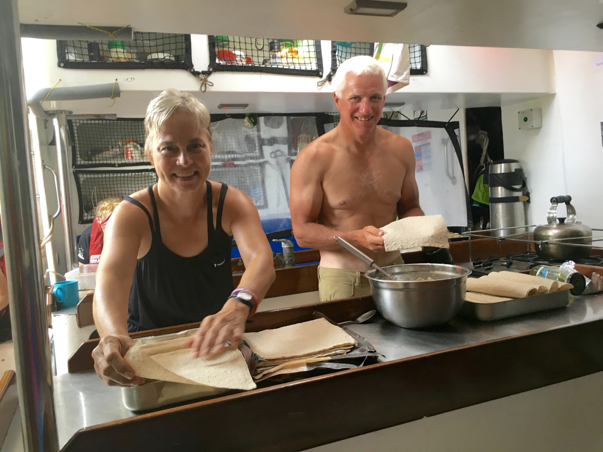 Ryan and I making wraps, as near to naked as we dare in the 40+C degree heat - Do we really have to bake bread? No oven on, please!!!