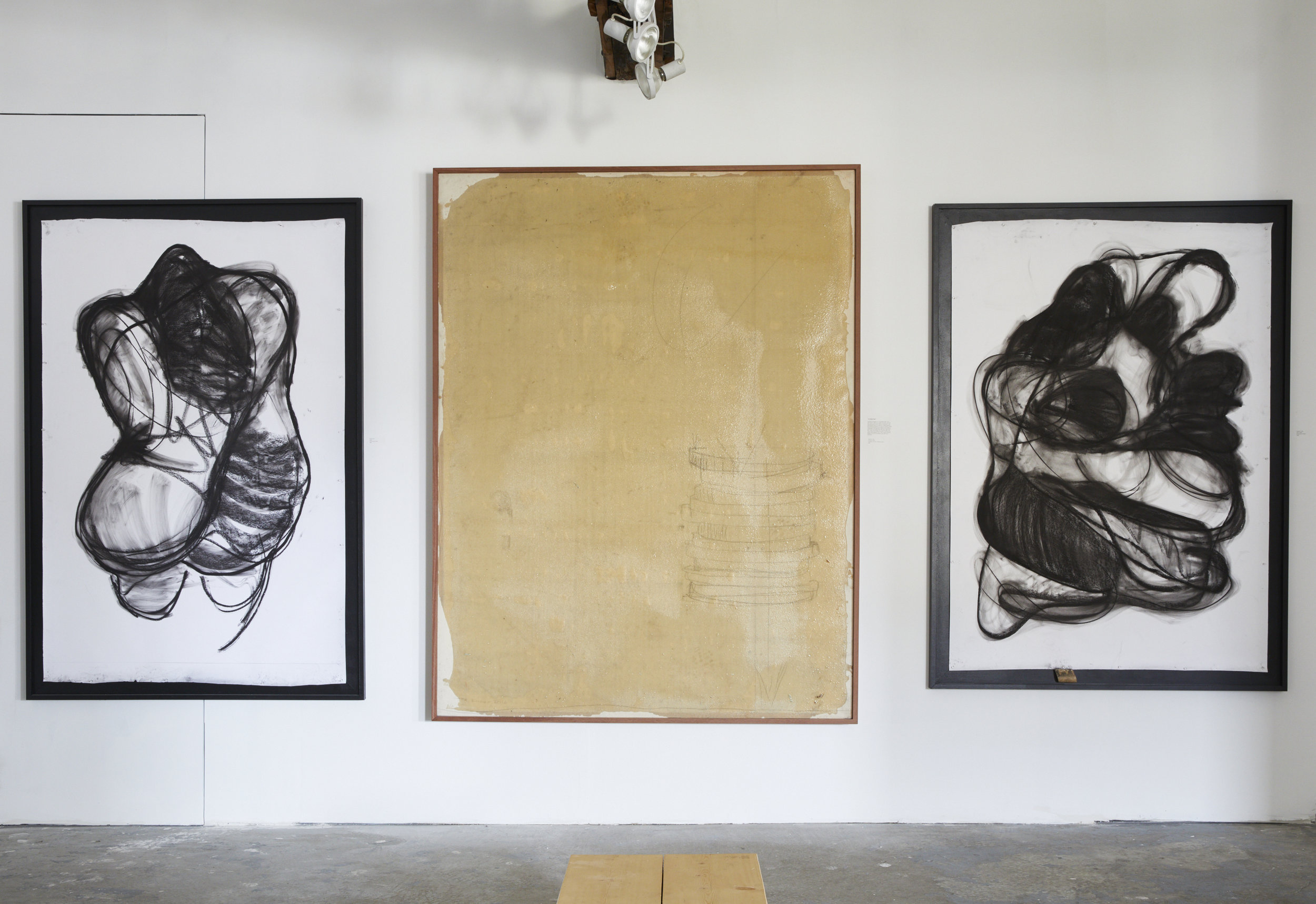 "Left to right: ""Helen,"" 2017 Charcoal on paper 78.5"" h x 53.5"" w  ""Counting Chips,"" 2000-2017 Graphite, grit, footprints, epoxy on canvas 85.5"" h x 65.5"" w  ""The Couple,"" 2017 Charcoal on paper 74,5"" h x 53.5"" w"