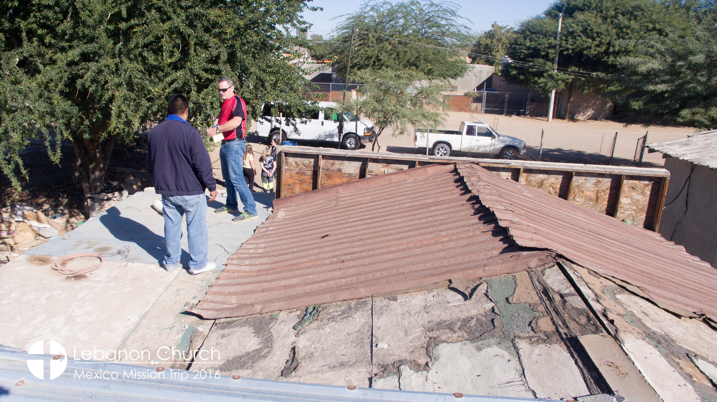 Marcelo and dave taking measurements on guadalupe's roof