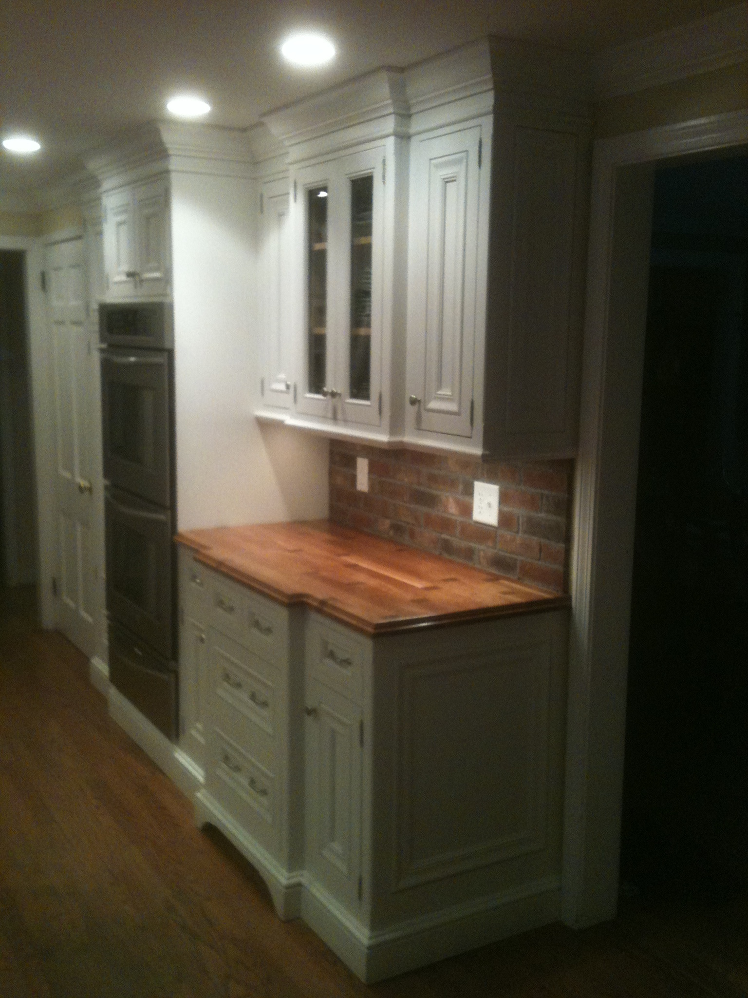 Painted kitchen cabinets with wood countertop