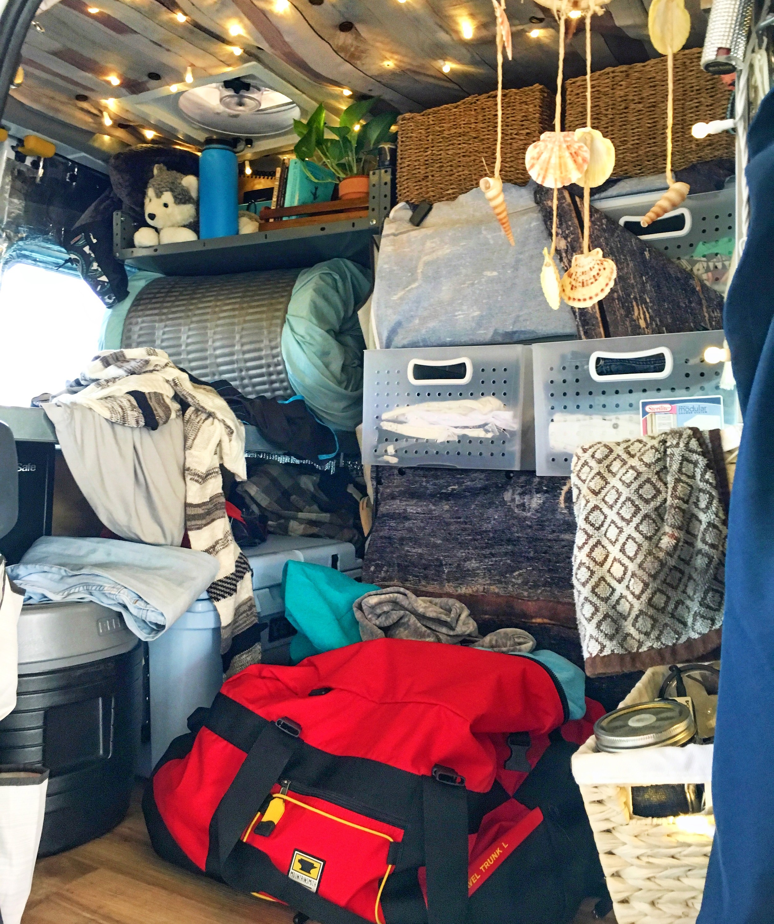 It wasn't always so organized in here, though... I used the  Mountainsmith Travel Trunk  to carry my entire wardrobe to the van in one trip when I was moving in.