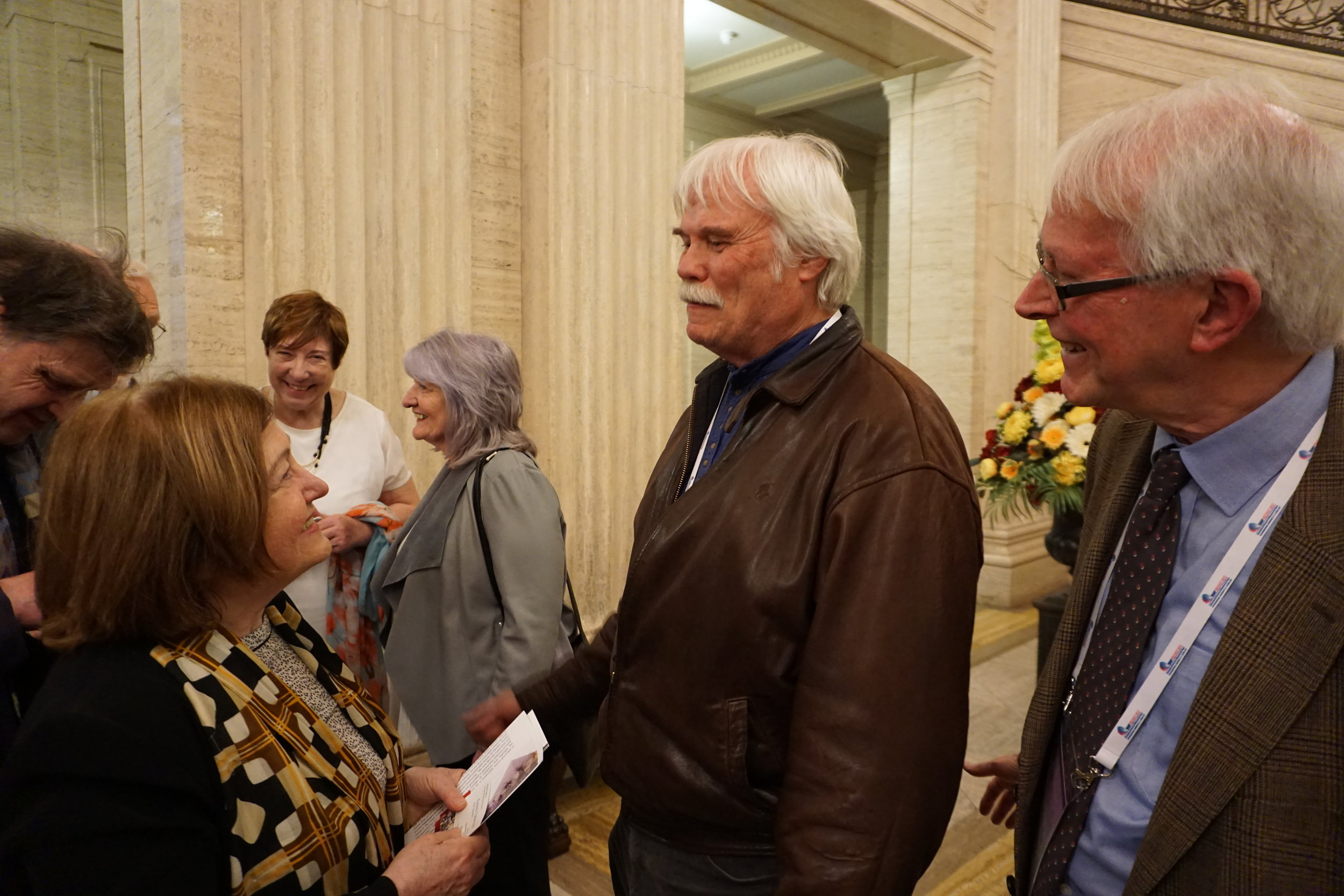Museum Director, Michael Kalter and the INMB Director talk with Nobel Peace Prize winner, Mairead Maguire at Stormont, the Northern Ireland General Assembly.