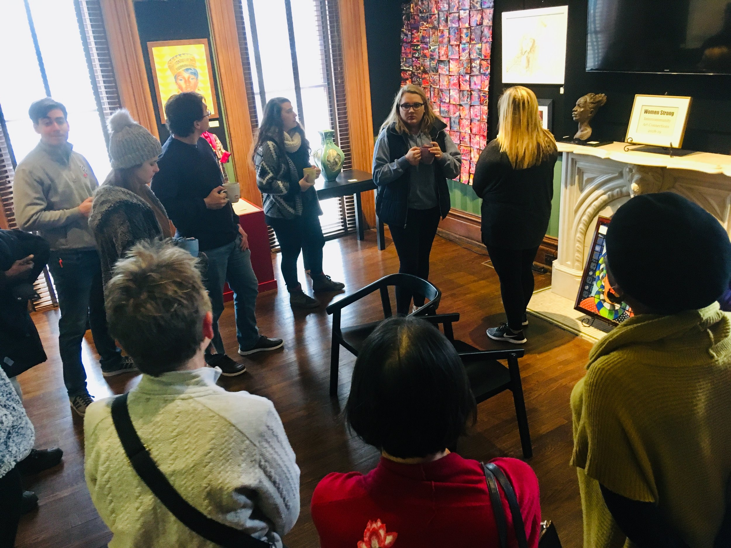 Artists of the Woman Strong exhibit answer questions from University of Dayton students touring the multi-discipline art exhibit in December 2018.
