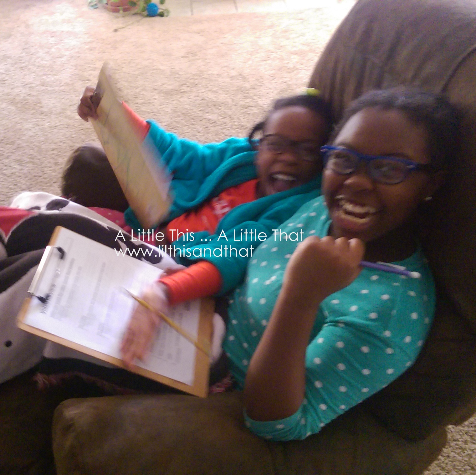 The girls are ready to watch the Visual Learning Systems weather video. The picture is blurry, but I love their smiles. :)