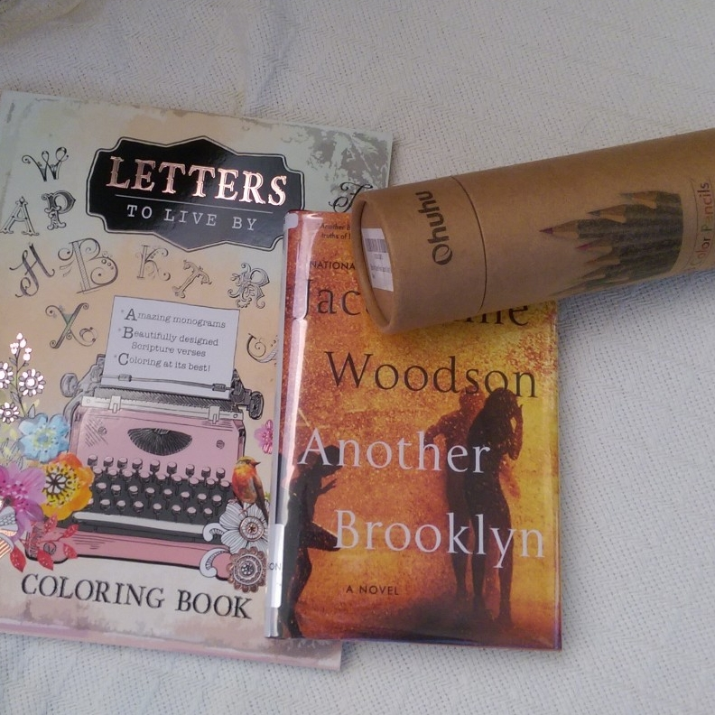 Books for flight: coloring book and Jacqueline Woodson's Another Brooklyn