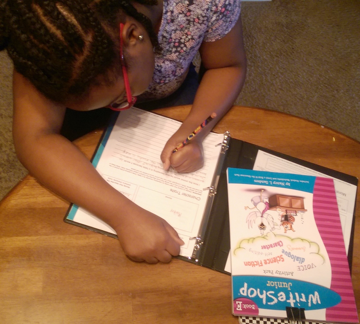 My oldest daughter working on her fable assignment with WriteShop Book E