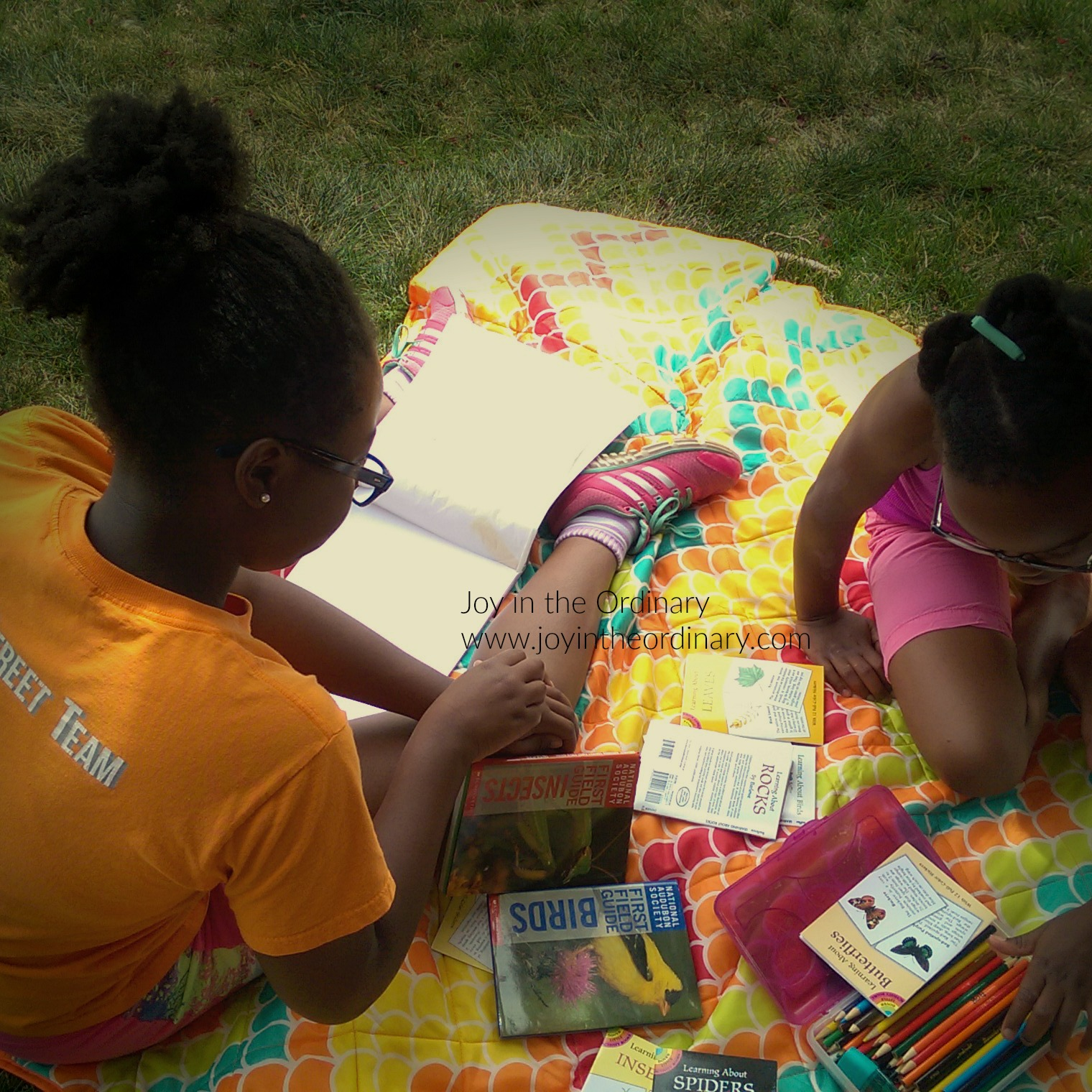 Girls studying nature outdoors.