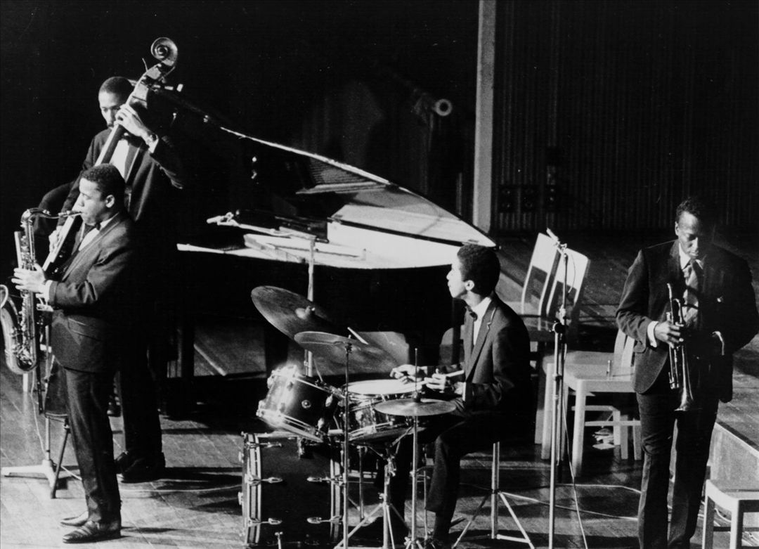 Pictured (L-R): Wayne Shorter, Ron Carter, Tony Williams, Miles Davis (Obscured at piano: Herbie Hancock)