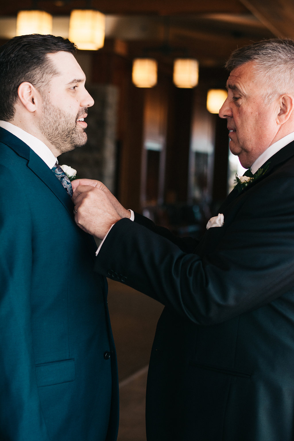 Mike's dad making sure he looked perfect for his first look with Kristin