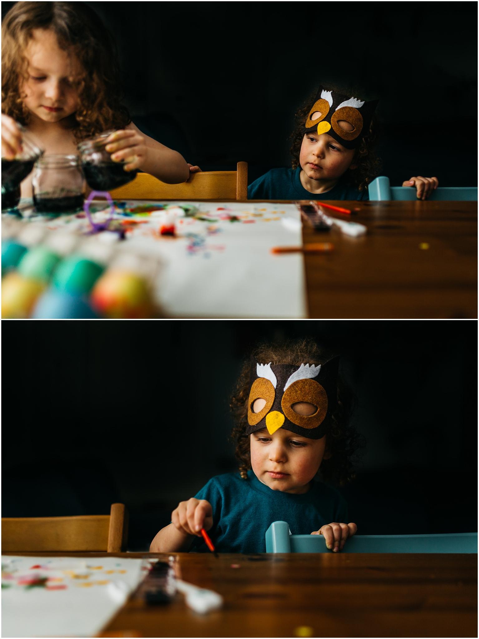 Easter Egg Painting - Edmonton Photographer - Edmonton Family Photographer -  Easter Eggs - Easter 2018 - Crayons on Easter Eggs - Edmonton Documentary Photographer - Family Photography - Documentary Photography - Owl Mask - Owl Costume - Edmonton Documentary Photographer - Lifestyle Photography