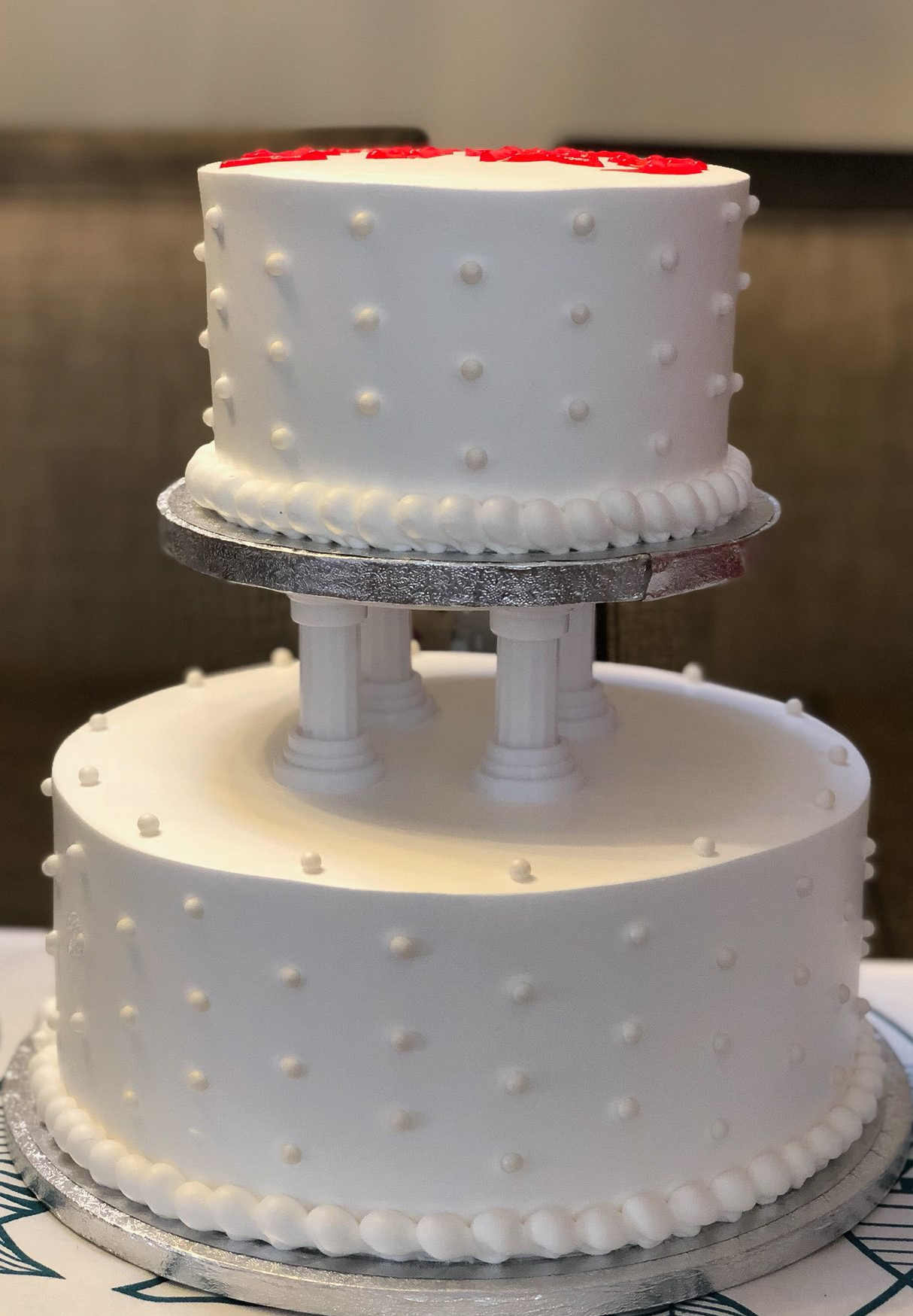 W7 - 2 layered cake decorated with Pearl Candies