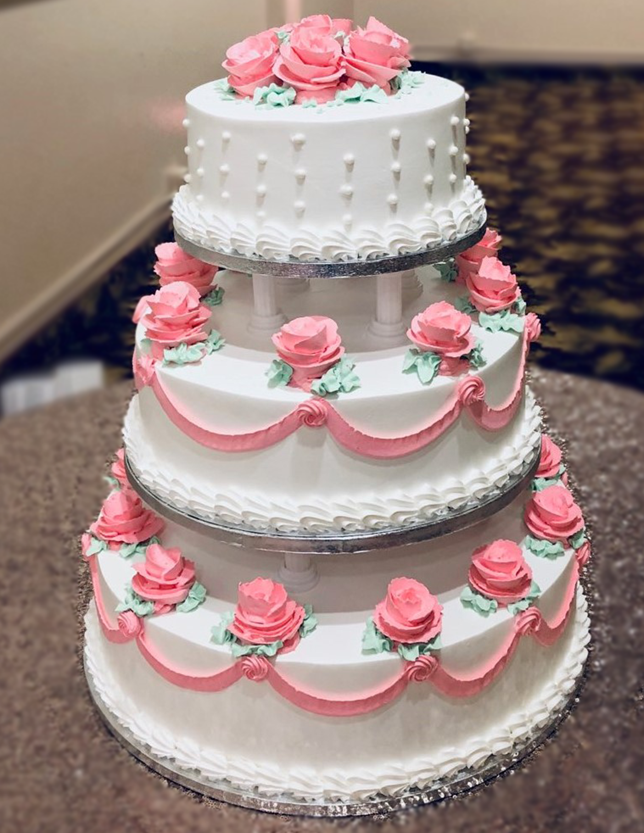 W8 - 3 layered cake decorated with butter cream pink roses & garland