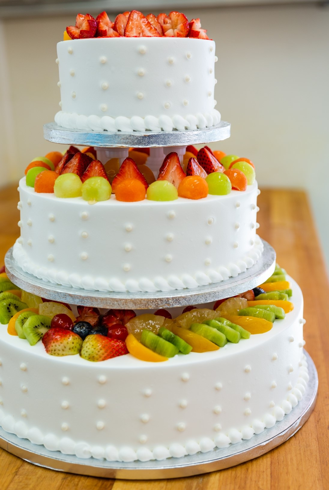 W9 - 3 layered cake decorated with mix fruits