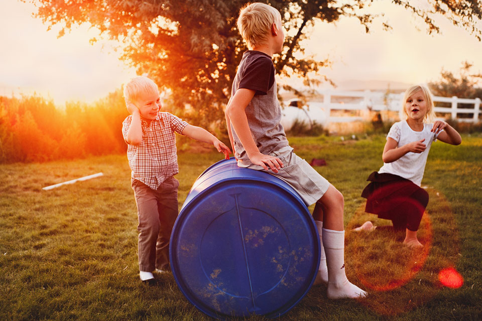 kids-playing-outside-barrel.jpg