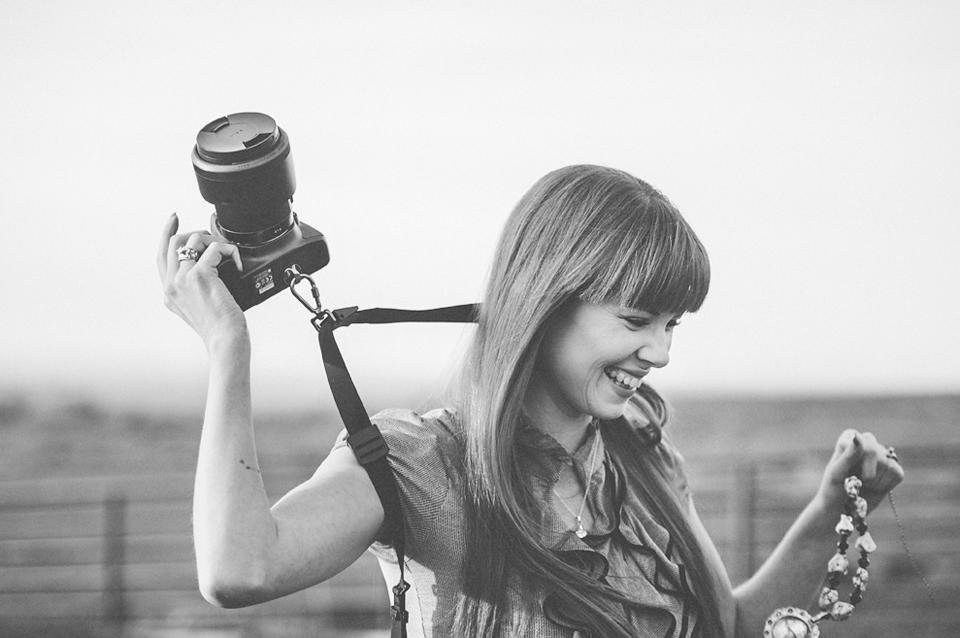 woman taking off camera