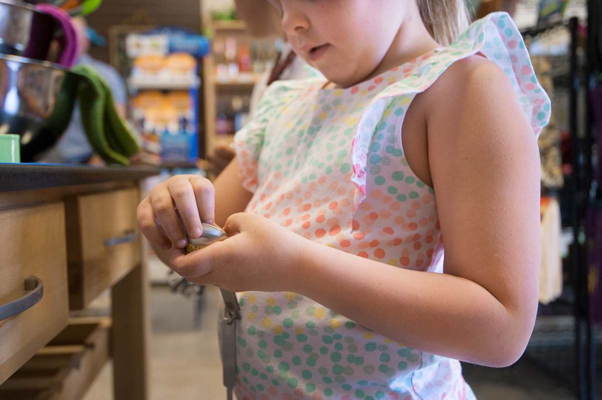 girl looking at item in store