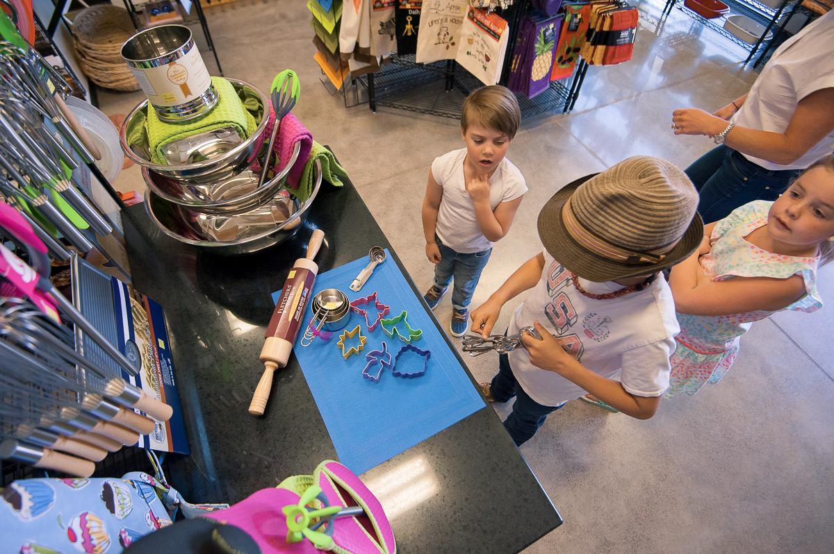 kids looking at cookie supplies in store