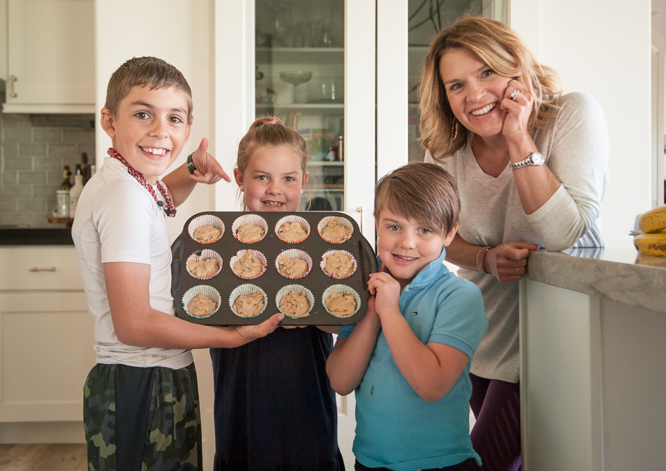 family showing muffins in pan
