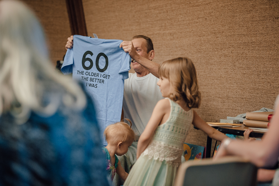 guy holding happy 60th shirt