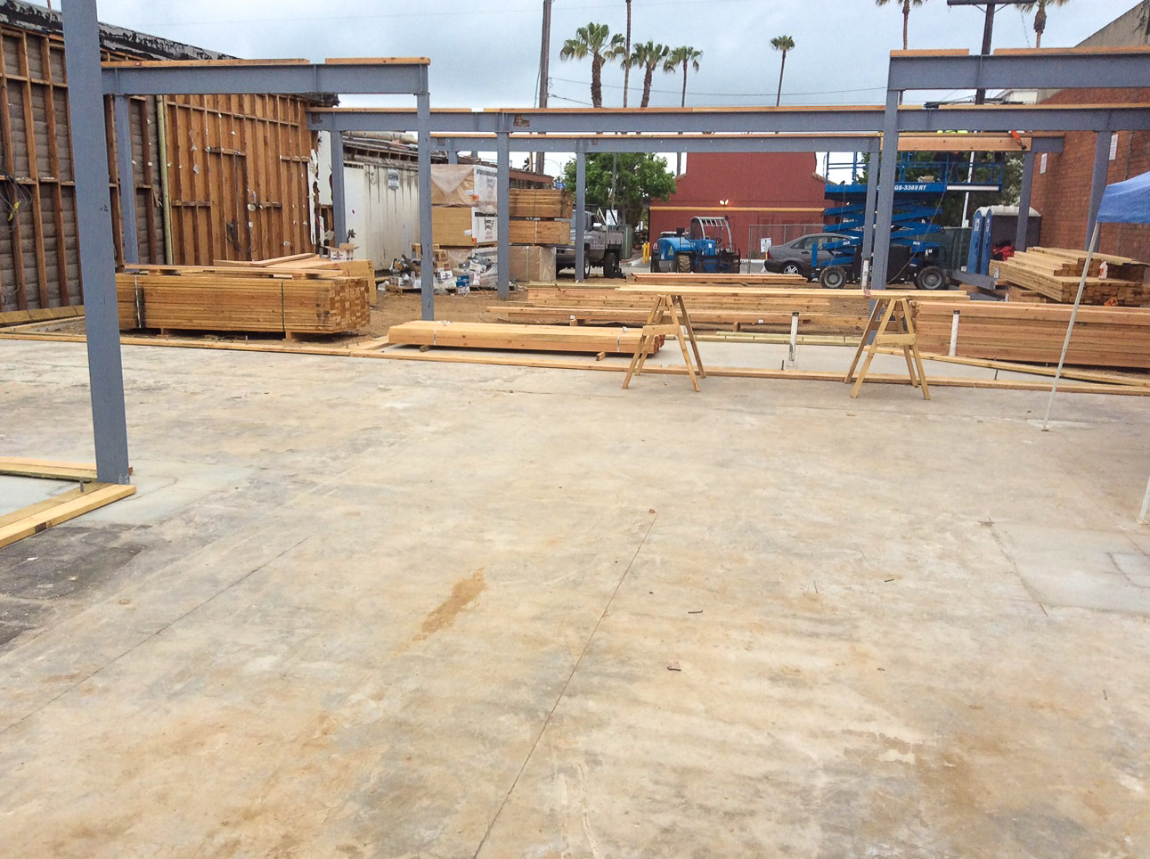 As H&R Steel finishes setting their first floor structural steel, the lumber is offloaded and D.A. Whitacre, a long time leader in San Diego carpentry,has stepped on site. Their framing is now underway at Hornblend Offices in Pacific Beach, Ca.