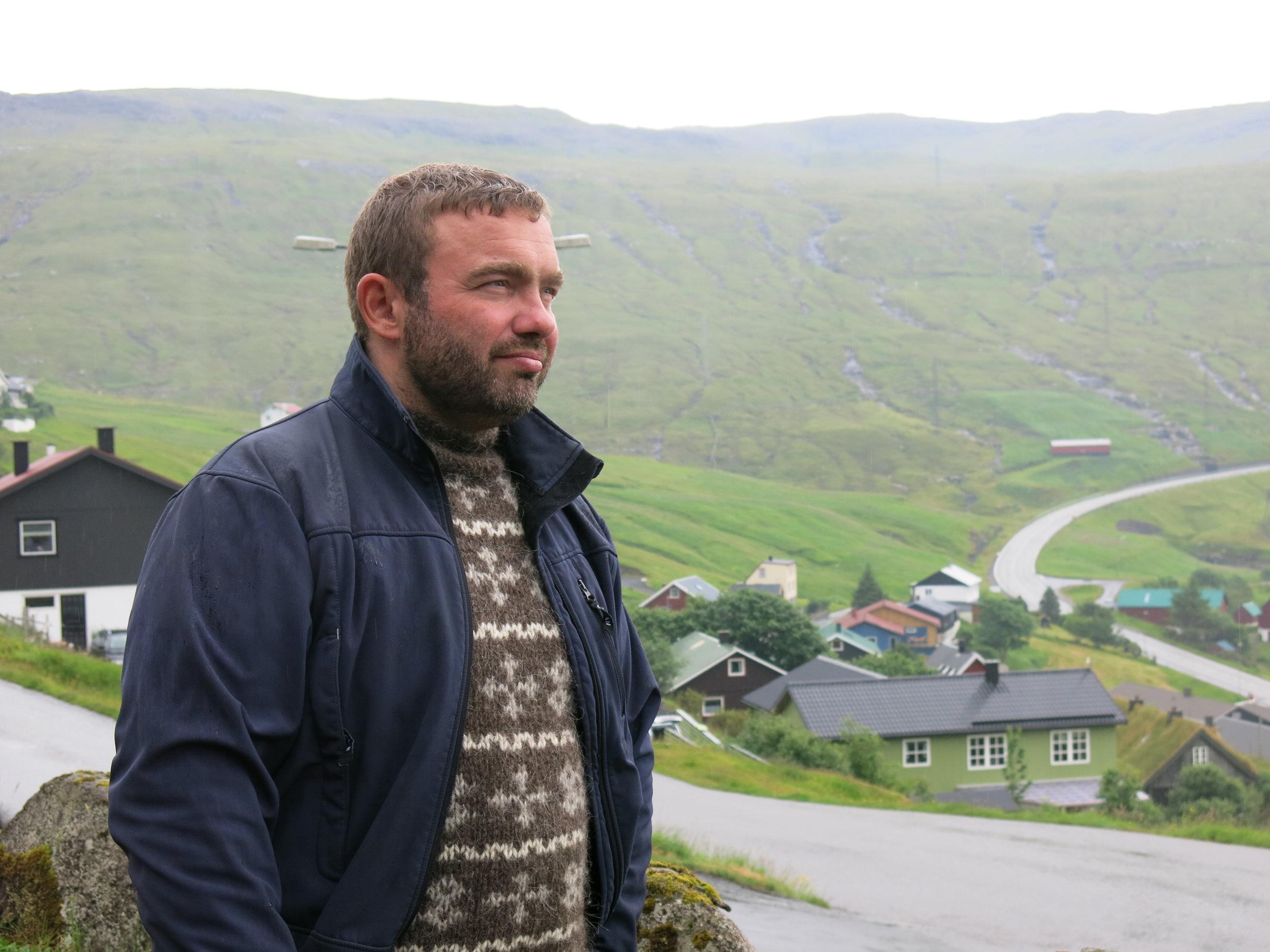 Jens Mortan Rasmussen, overlooking Vestmanna beach, one of the Grind killing beaches - The Grind (Joel Carnegie)1.JPG