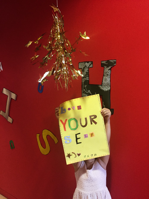 …from a past kids workshop at the MCA making posters with their own messages. This was Laly's message to the world: LOVE YOURSELF.