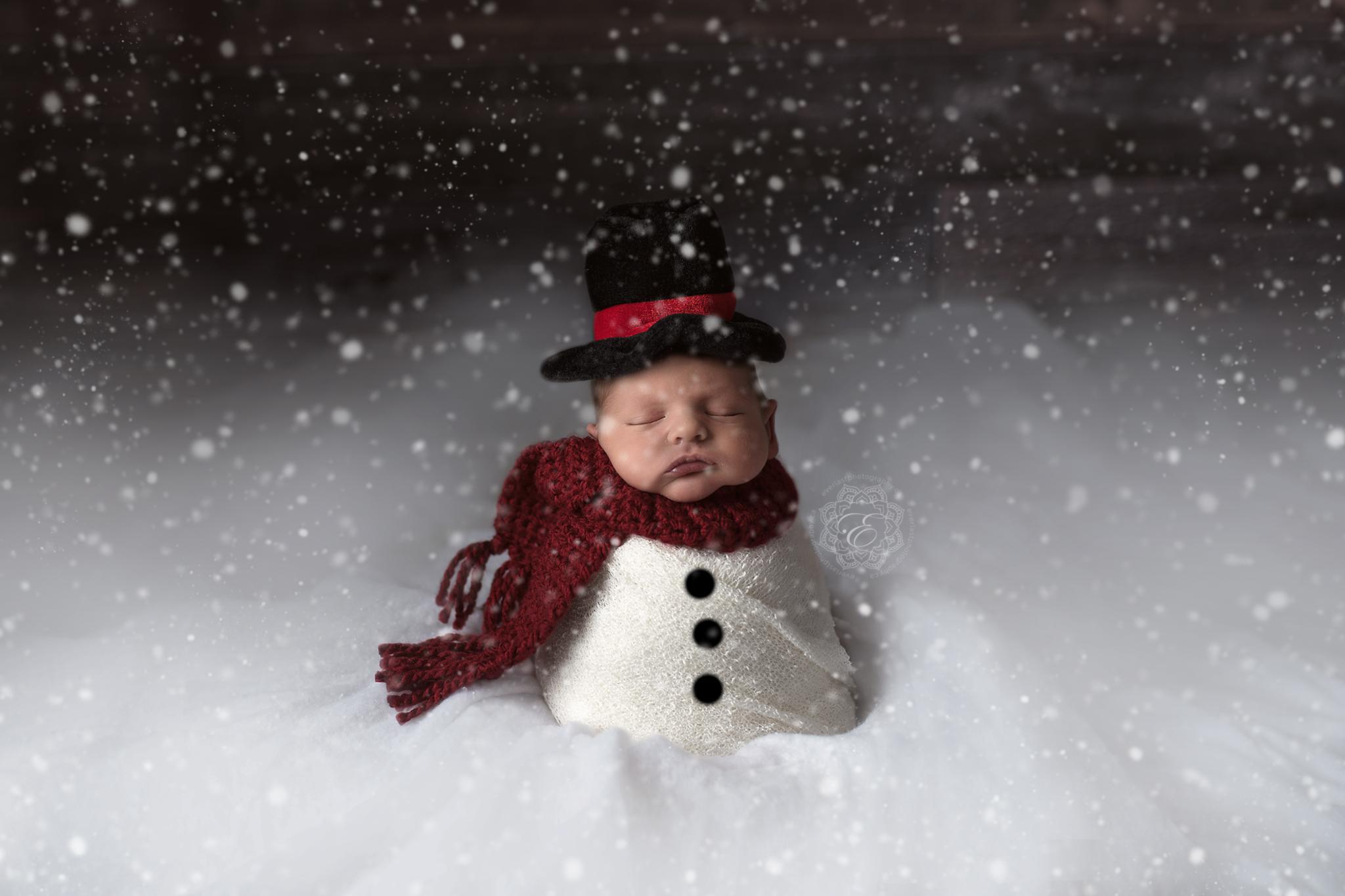Snow falling on baby snowman