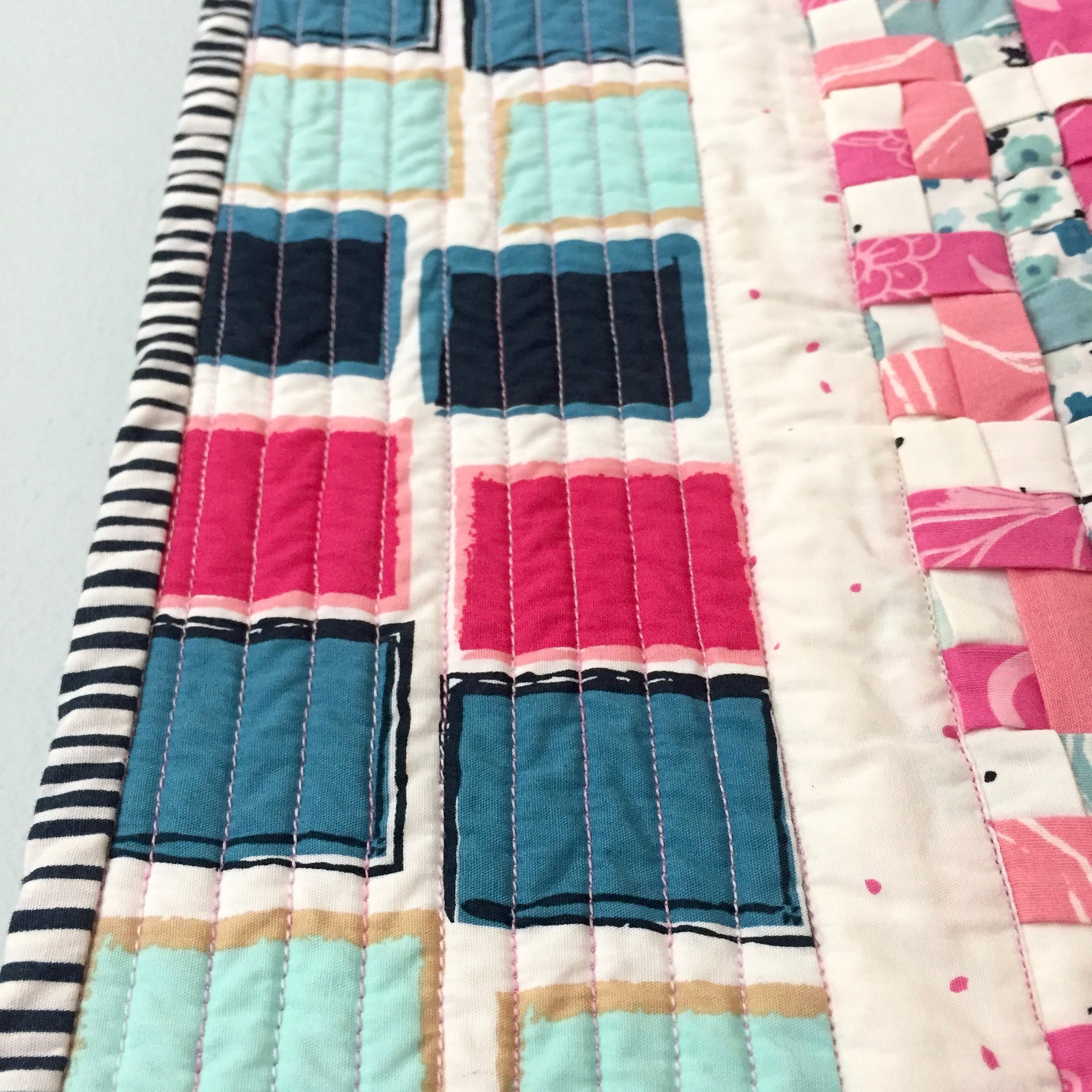 Straight line quilting with Superior Threads King Tut variegated thread.