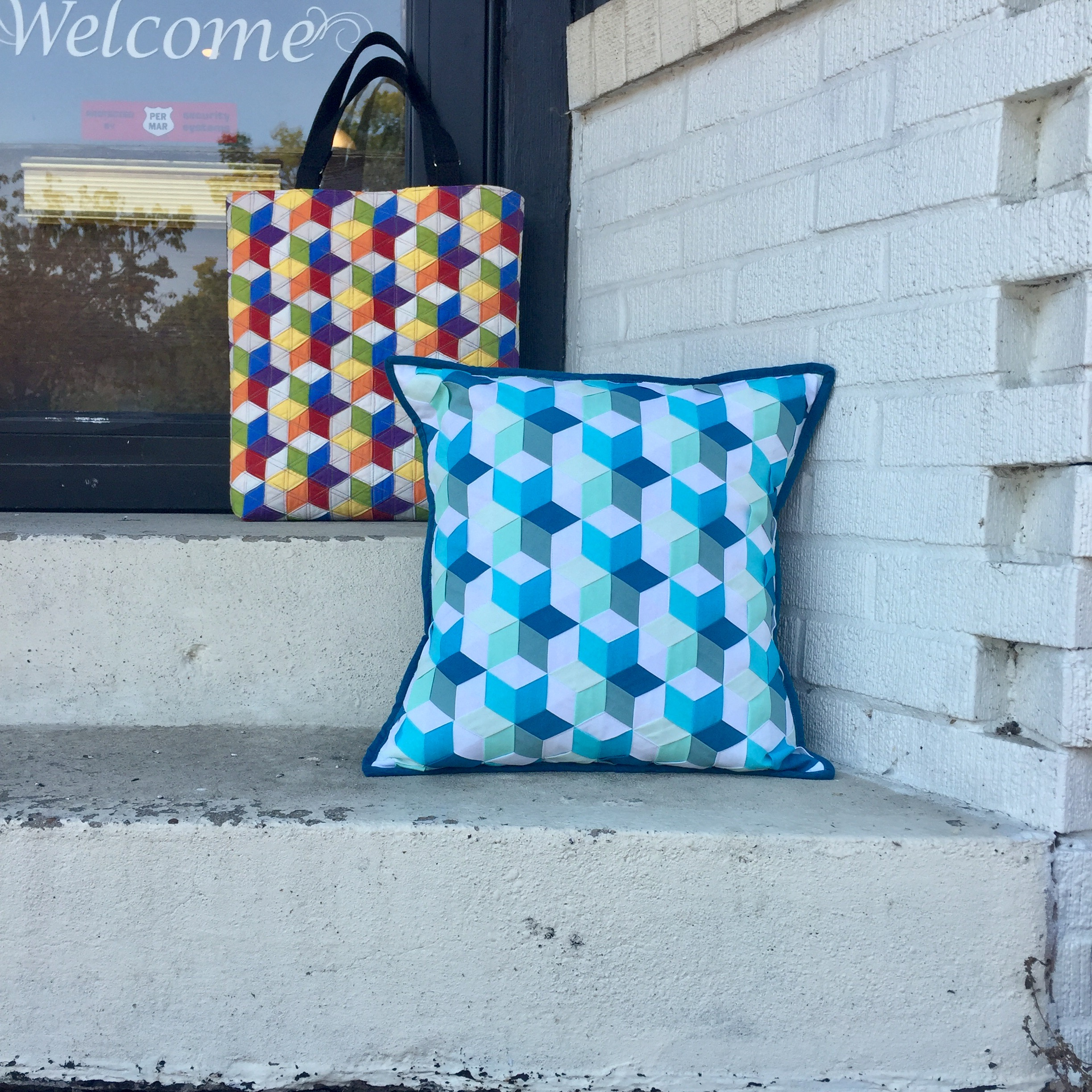 The Rainbow Stars Tote and Ocean Stars Pillow, both made of American Made Brand solids.