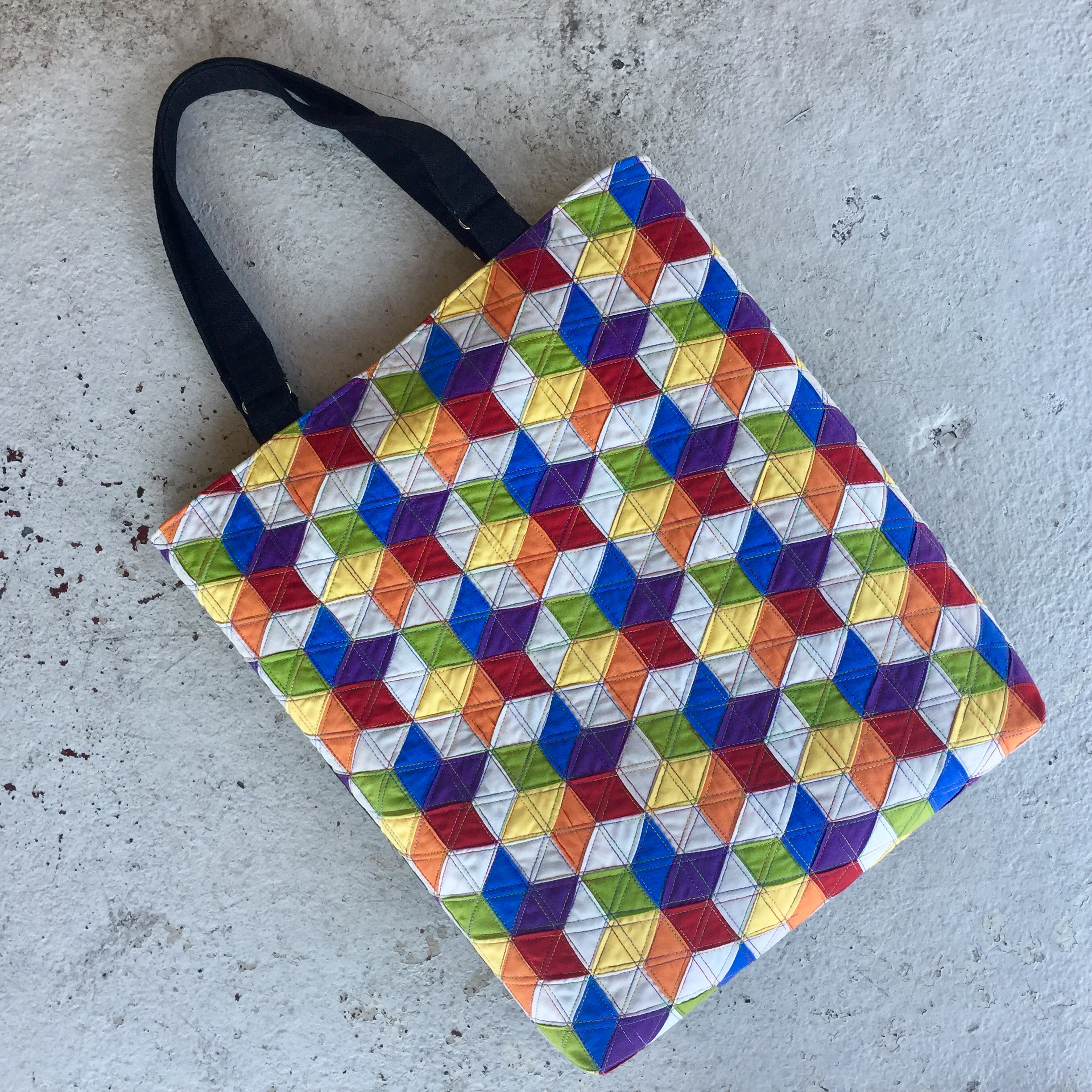 """The Woven Star Variations Tote measures 15"""" wide, 16"""" tall, with a 2"""" opening. The lining features slip pockets on both sides."""