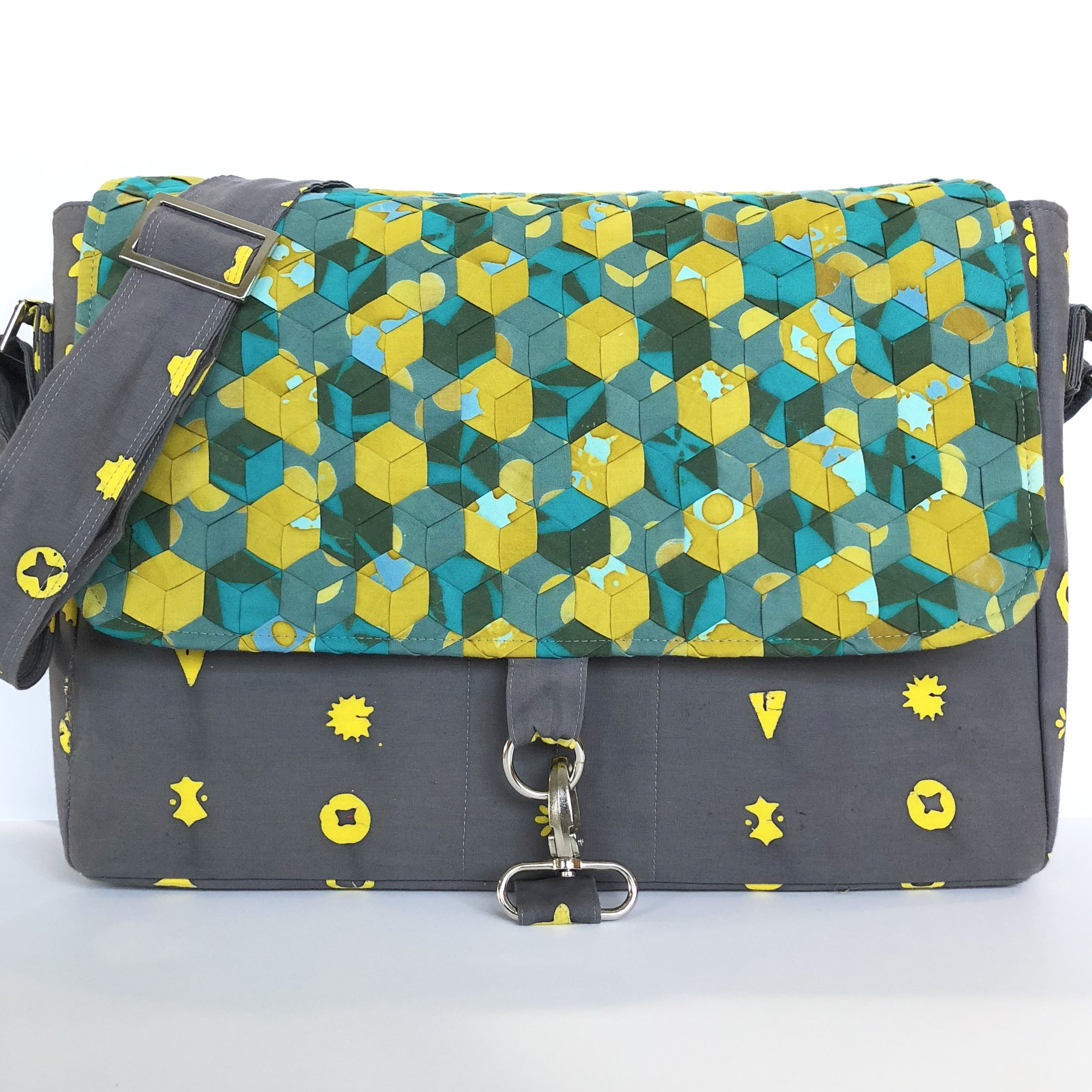 Tumbling Triplets panel by WEFTY made into the Marigold Messenger Bag.