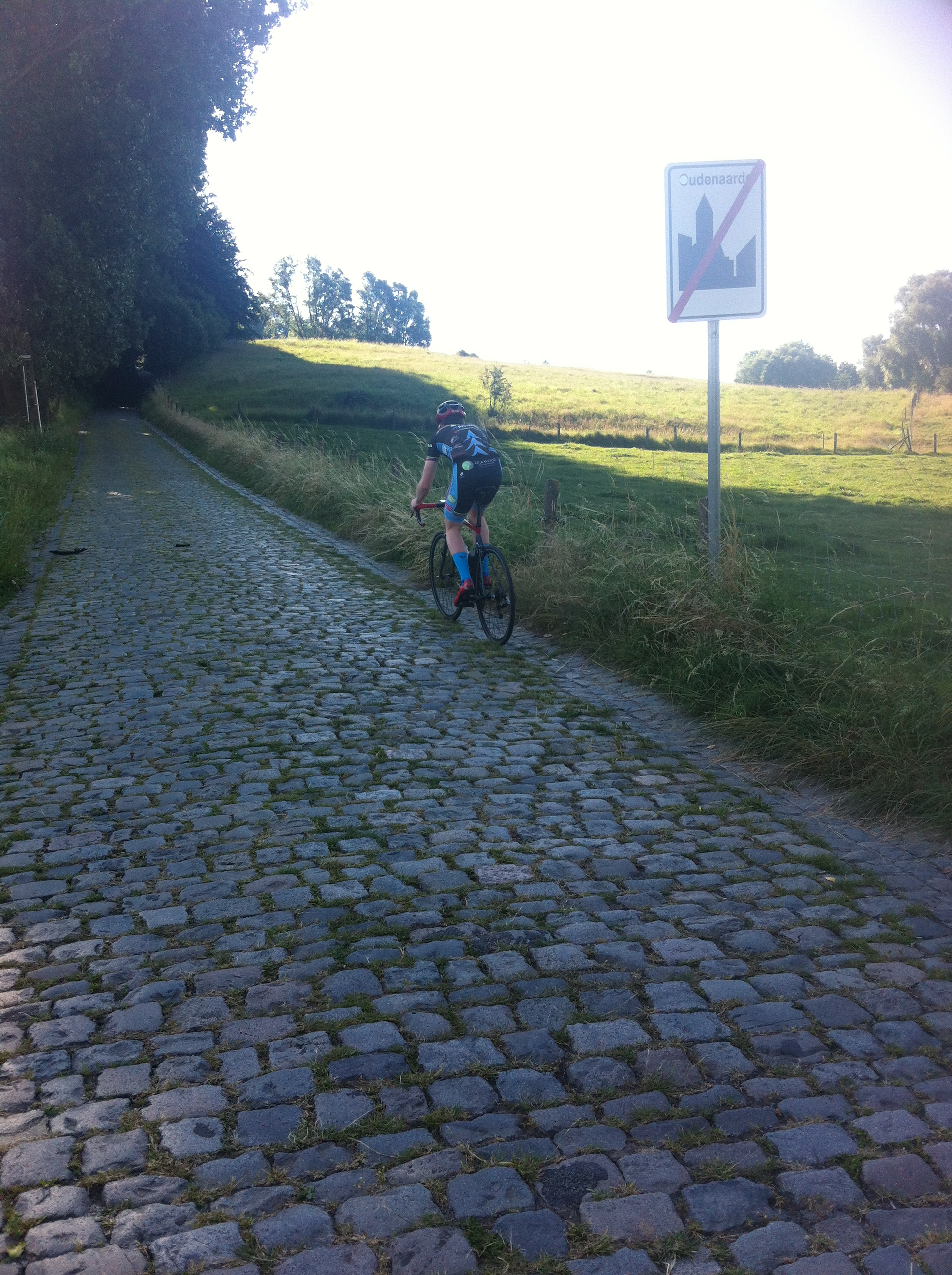 Approaching the Koppenberg ... under the trees the gradient is 22% and Conor used 38 x 28.