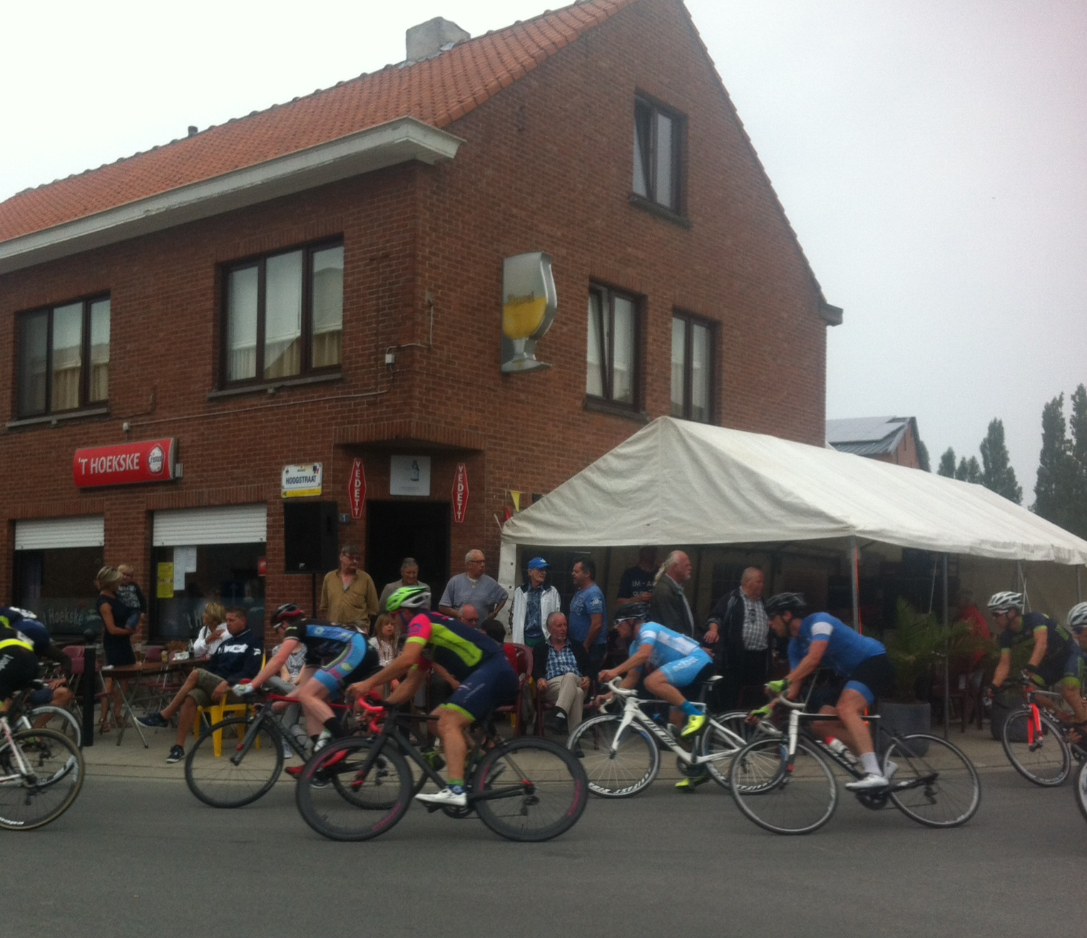 Conor passing the 'T Hoekske Pub before the Bazel finishing straight. Serves a great Westmalle Triple ...