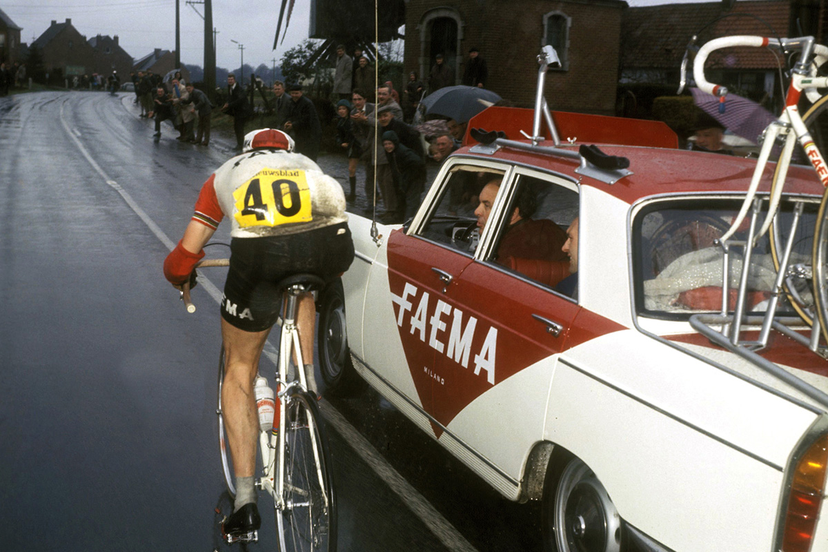 Eddy Merckx in the pouring rain at the 1969 Tour of Flanders with 70k to go with Lomme Driessens asking him to slow down & wait (good luck with that Lomme). The Faema car is the Peugeot 404 (designed by Pinafarina) used by many pro teams and at the Tour de France.