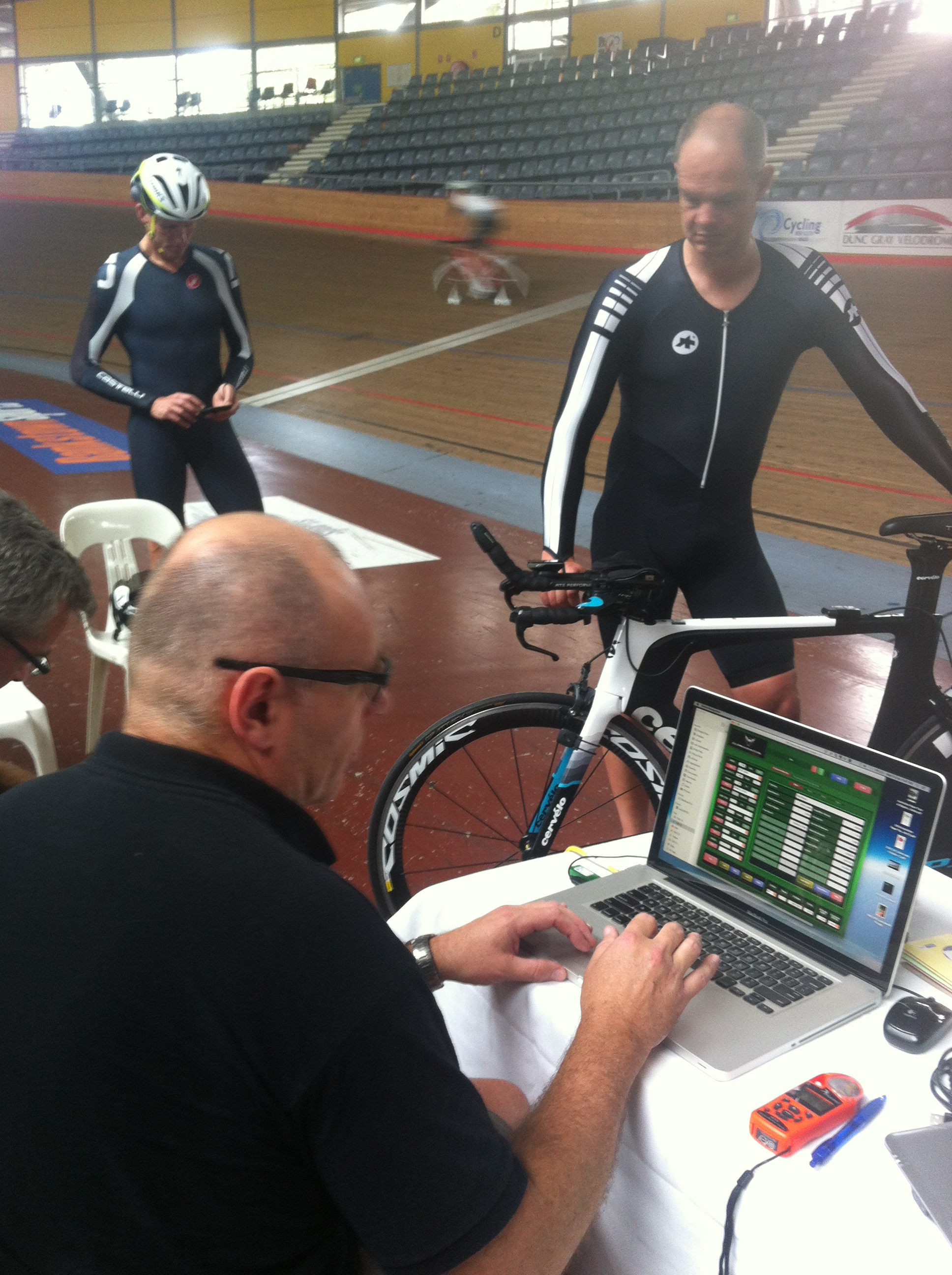 Alex Simmons at DGV doing aero testing and Mark Renshaw (white blur) circulating in the background.