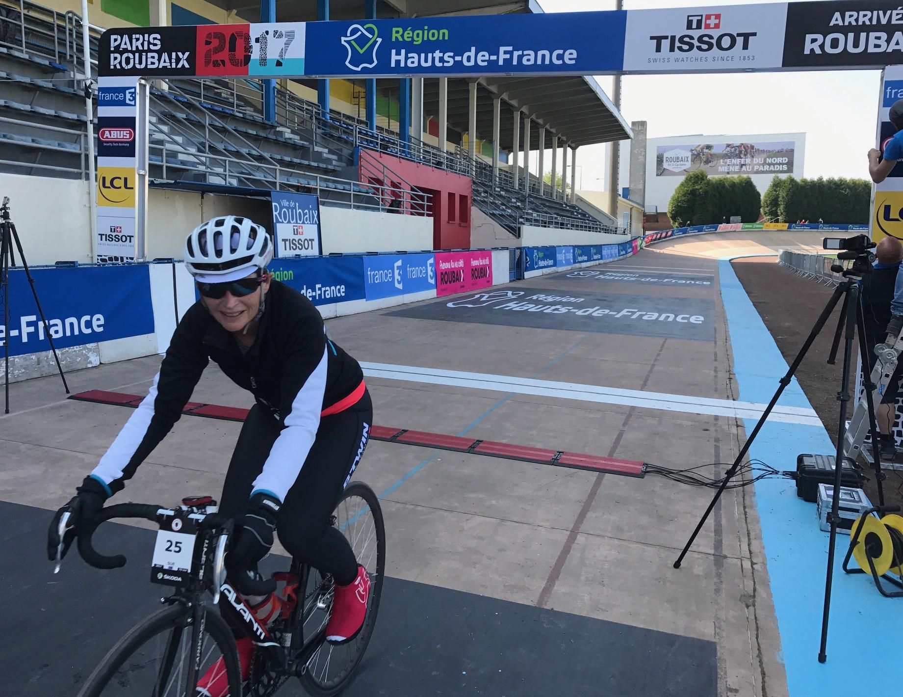 Paris Roubaix Cyclosportive 17 - Sue Tierney crosses the finishing line of the Roubaix Velodrome