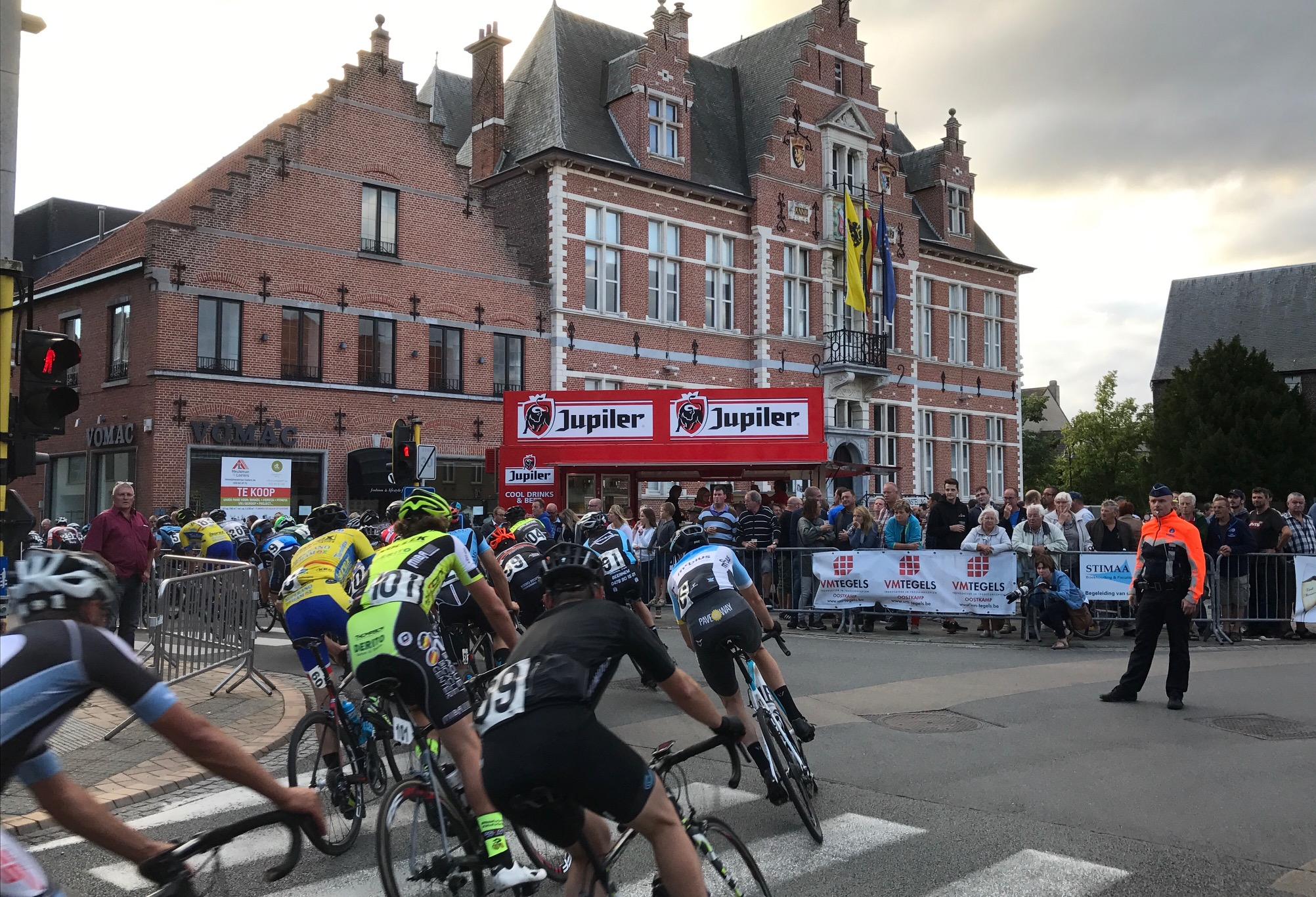 Flanders 17 - Peter Livingstone (BiciSport-Mobius light blue jersey in centre of shot) heads for the Jupiler beer tent (as you do) on the bell lap at the Oostkamp kermesse over 100k run off at a brisk 45+kph.