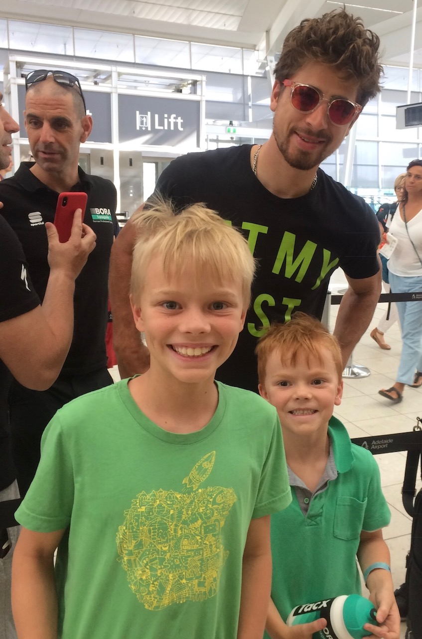 """Tour Down Under 18 - Lawson & Campbell Browne at Adelaide Airport with one particular Peter Sagan who was departing Adelaide after the TDU. Peter's t shirt reads ... """" Eat My Dust """""""