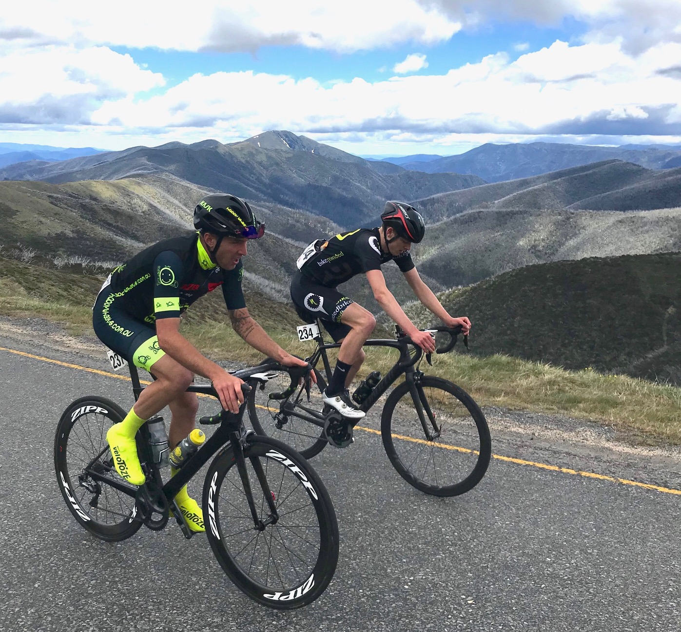 Tour of Bright 18 @ 2 Dec - Declan Jones with a glimpse of the Mount Hotham summit