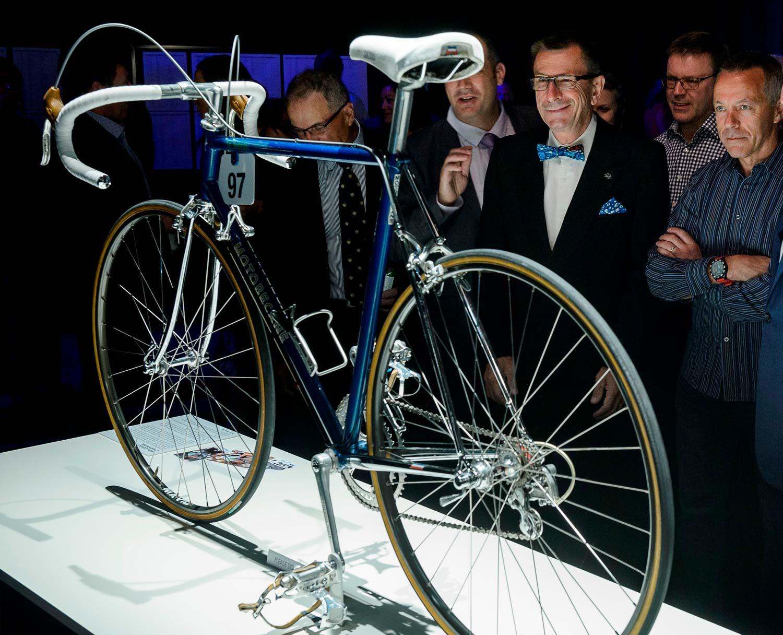 Tour Down Under Legends Dinner - featured Paul's 1983 La Redoute-Motobecane team bike with Paul admiring the thoughtful team bike restoration