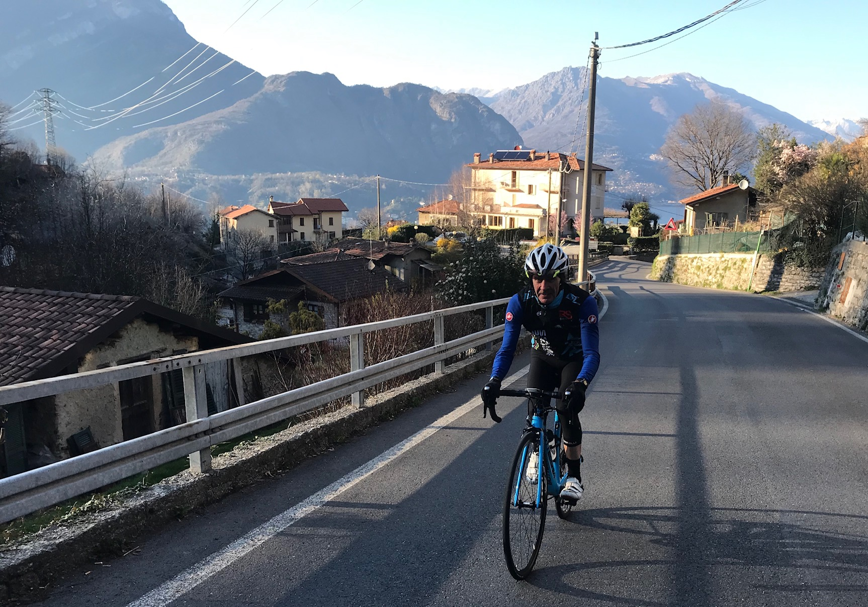 IL Perlo Hotel @ 20 Mar  - Mike Lawson heads off up the Ghisallo climb with the IL Perlo Hotel soaked in the afternoon sunshine