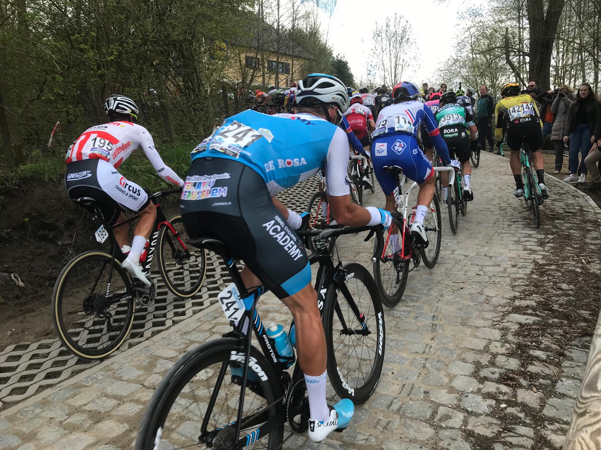 Dwars door Vlaanderen @ 3 April -  the steep corner at Berg Ten Houte cobbled climb. Photo MOR