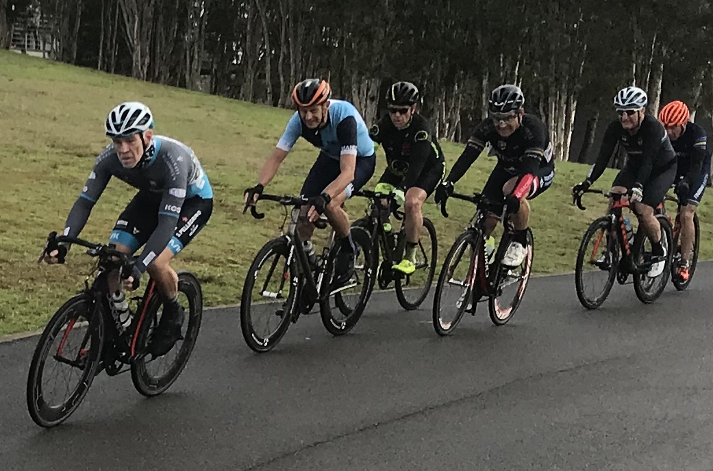 Metropoltian Championships @ Penrith Lakes @ 6 July - M6 peloton leading into the finishing straight with Matt Coy (Pilu Racing) and Peter Budd (Happy Wheels) in third wheel