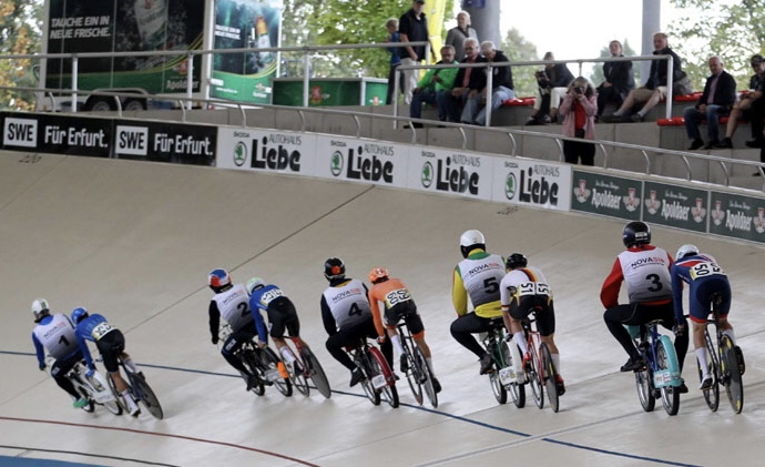 """Dernys in action at the Velodrome - Each rider is allocated a derny & the """"bigger/fatter"""" the derny driver the better to assist with slipstreaming (thin drivers need not apply). Clothing rules also apply for derny drivers (drivers are not permitted to intentionally layer up). Hence, """"natural layering"""" the preferred option."""