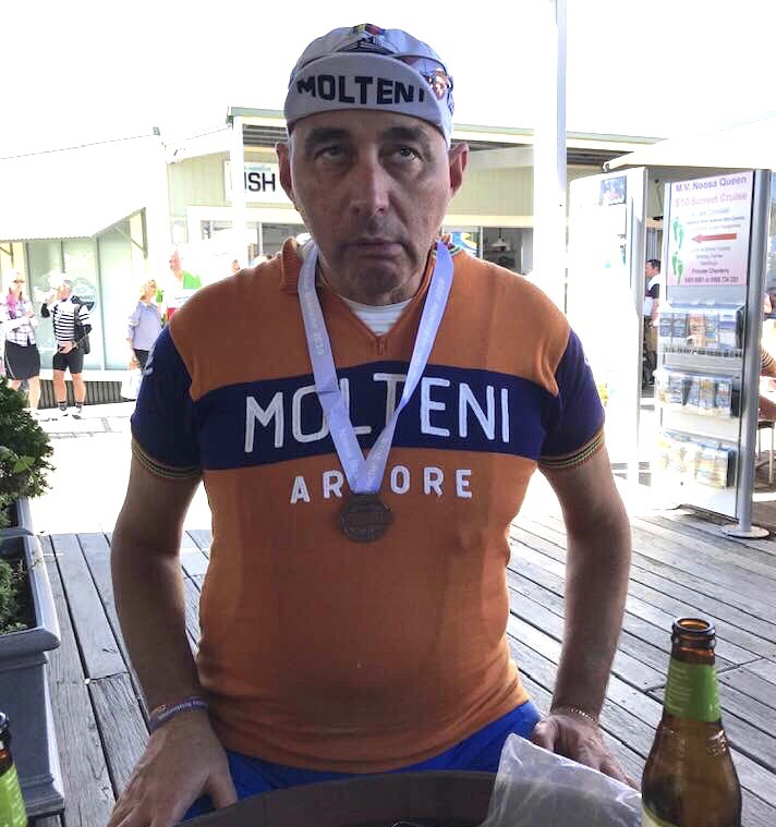 Strade Bianche @ Noosa @ 11 August - Mr Molteni was all smiles after completion of the Eroica Strade Bianche course with the prized finishing medal for the mandatory podium champagne spray