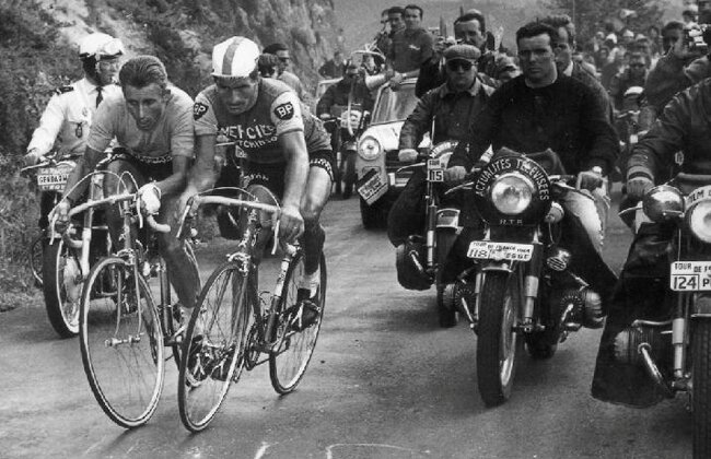 An iconic picture from the Tour de France 1964 - Jacques Anquetil (left, Yellow Jersey.) clashes with Raymond Poulidor (Mercier BP) on the Puy Du Dome climb